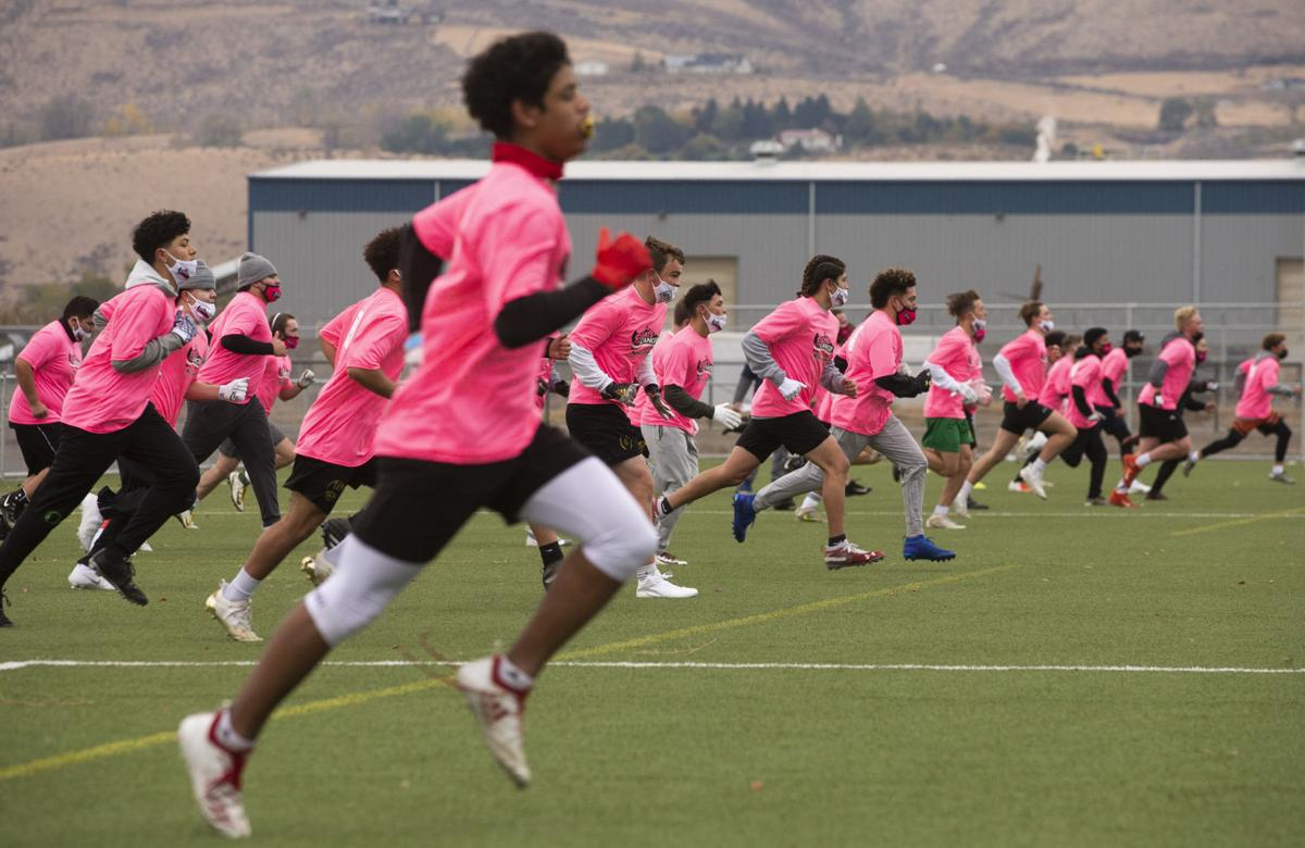 Nearly 100 football players attend Cleats Vs. Cancer minicamp at Sozo